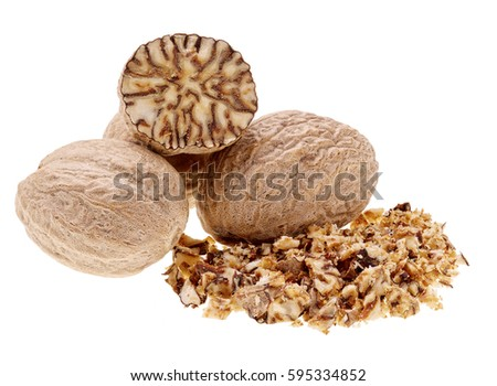 Whole, grained and half cut nutmeg isolated on white.  #595334852