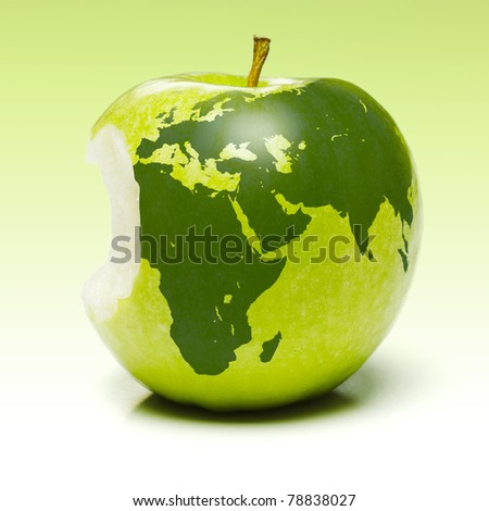 Whole green apple with planet earth map applied (Europe, Africa and Asia)