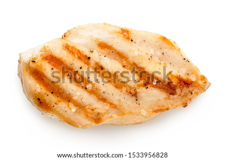 Whole grilled chicken breast with grill marks and ground black pepper isolated on white. Top view.