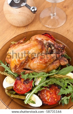 whole grilled chicken garnished with vegetables