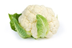 Whole head of the fresh raw cauliflower with some leaves close-up on a white background