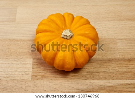 Whole miniature pumpkin called Gold Dust