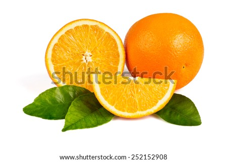 Whole orange, half an orange, orange slice in the peel on the green leaves on a white background