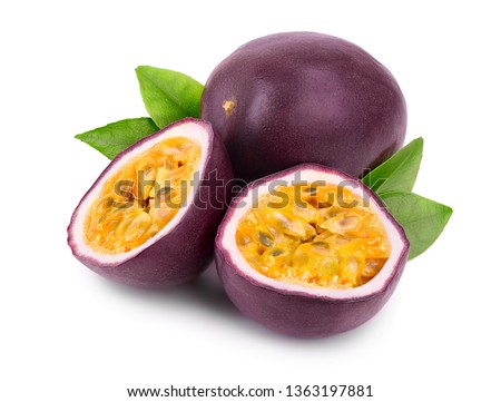 whole passion fruits and a half with leaves isolated on white background. Isolated maracuya