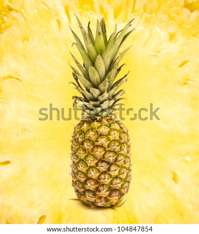 Whole pineapple on abstract background - stock photo