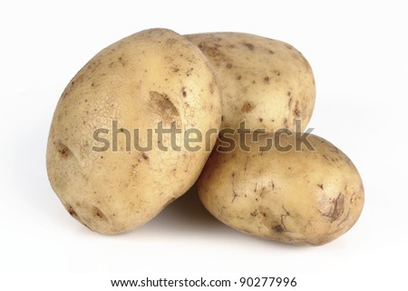 whole potatoes on a white background