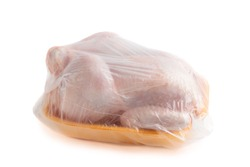 Whole raw chicken carcass on a shopping tray in a bag isolated on a white background with clipping paths with shadow and without shadow
