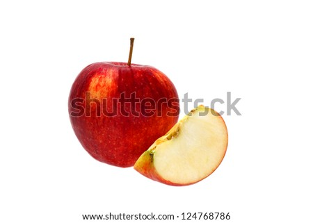 Whole red apple and a slice near it isolated on white background
