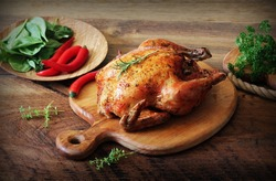 Whole roasted chicken on cutting board. Vintage photo