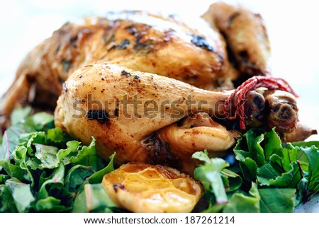 Whole roasted chicken served up as a main with vegetables  - stock photo