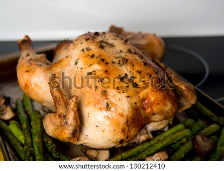 Whole Roasted Free Range Chicken Served wit Asparagus and Mushrooms