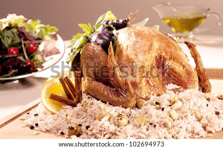 whole roasted stuffed chicken with rice and vegetables