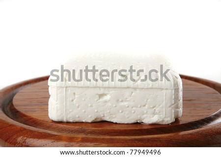 whole soft cheese on dishware isolted over white