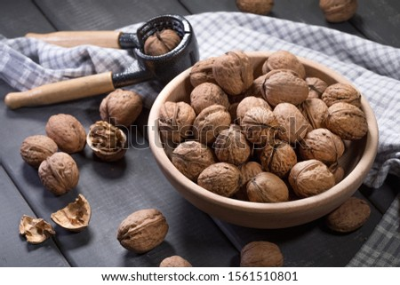Whole walnuts in a wooden bowl. Shallow depth of field. #1561510801