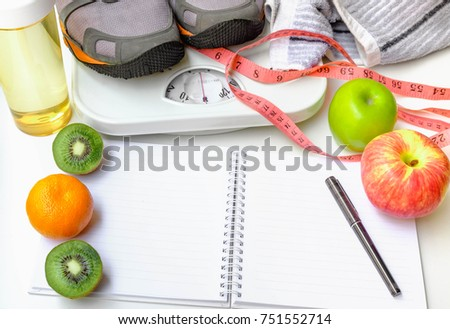 Whole wheat bread with pink measuring tape and fruits,Notebook and pen on white table. Selective focus.Health care concept.