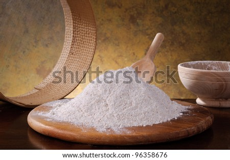 Whole wheat flour on wooden board