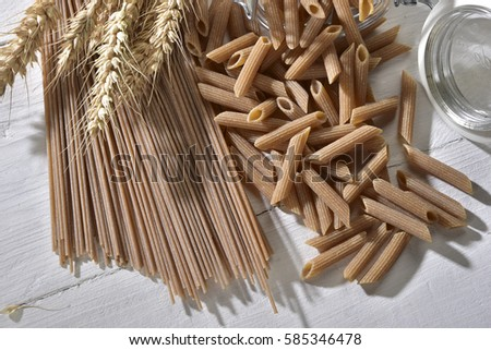 whole wheat pasta semolina on a table #585346478