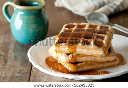 Whole wheat waffles with syrup.
