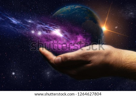 Whole world in hands and nebula dust. Mixed media .