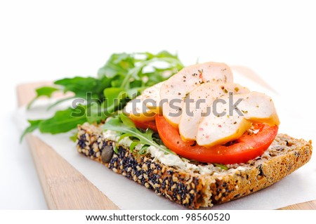 Wholegrain bread with salad and smoked chicken breast, healthy living concept - stock photo