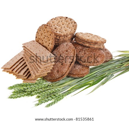 wholegrain crispbread and wheat spike isolated on white background