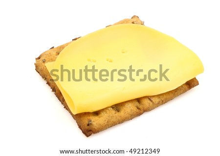 wholemeal cracker with dutch gouda cheese on a white background
