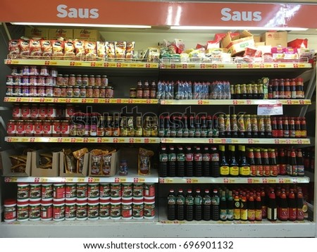 Wholesale at Jakarta, August 15, 2017. Sauce stock on the rack, lined and solid #696901132