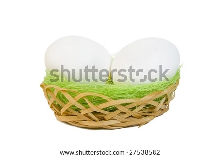 Whtie eggs with grass in a basket. Clipping path included.