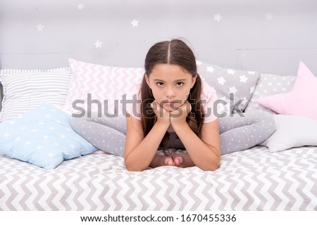 Why so sad. Sad girl sit in bed. Little child with sad look. Bedtime routine. Daytime nap. Kids health. Childcare. Early morning hour. Good night. Unhappy and sad.