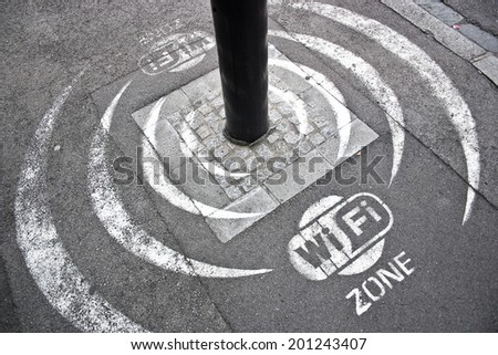 Wi Fi zone sign on the asphalt street.