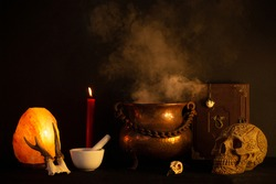 Wicca ritual set up with skull, candle and cauldron