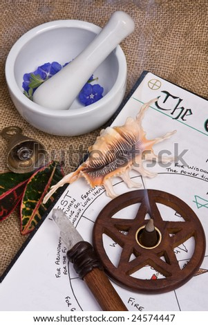wiccan ritual tools with book of shadows