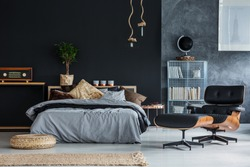 Wicker accessories in black and grey modern bedroom