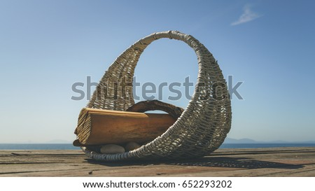 wicker basket and wood branches ...