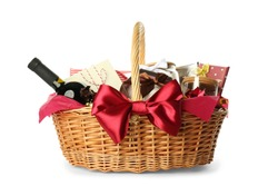 Wicker basket full of gifts isolated on white