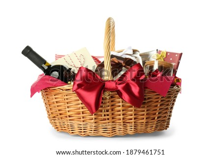 Wicker basket full of gifts isolated on white Stockfoto ©
