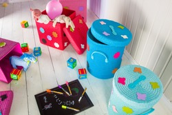 Wicker basket of colored storage and toys