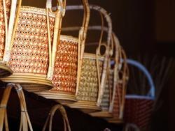 Wicker basket, wickerwork of wooden patterned hand-made basket in Thailand old market. Weaved baskets, Rattan Thai traditional handicrafts bamboo basket.