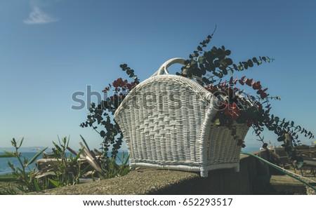 wicker basket with dry flower...