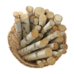 Wicker basket with firewood on white background, top view