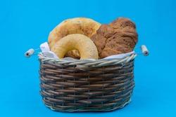 Wicker basket with fresh bread, pita bread and bagel.