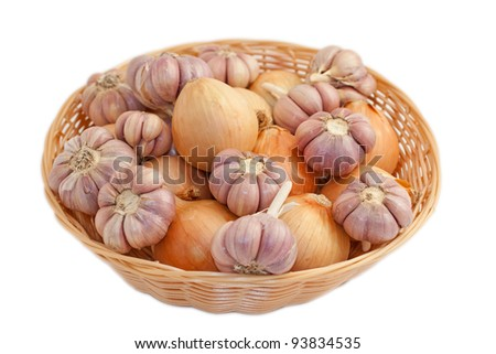 Wicker basket with onion and garlic bulbs