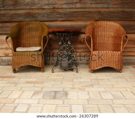 Wicker chairs and the sophisticated table (made from sewing machine) encourage to relax