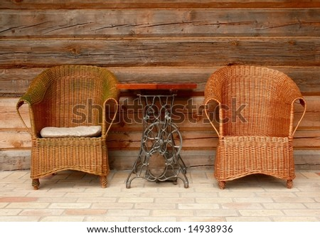 Wicker chairs and the table made from sewing machine
