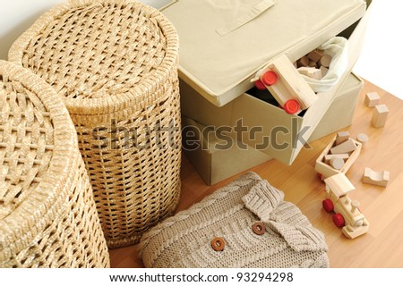 wicker containers for home, on wooden floor, top view