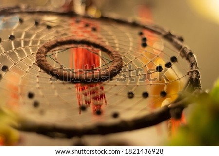 Wicker dream catcher. Amulet for scaring away evil spirits. Decoration for the room. Woven threads on a circle. Photo stock ©