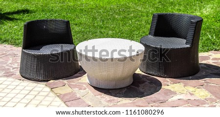 Wicker furniture for relaxation near the pool #1161080296