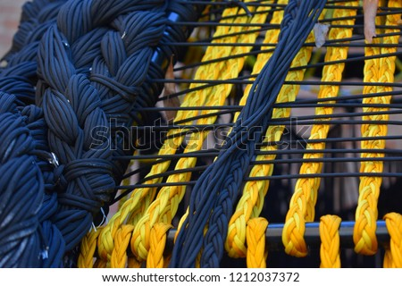 wicker furniture fragment, interlaced threads black and yellow #1212037372