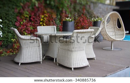 Wicker furniture on the relaxing area at the hotel resort  #340885736