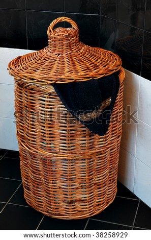 Wicker laundry basket and a towel